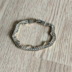 Simple gold bracelet with small clear stones